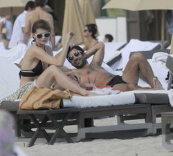 http://img121.imagevenue.com/loc106/th_312391444_Mischa_Barton_Bikini_Candids_on_the_Beach_in_Miami_December_27_2011_180_122_106lo.jpg